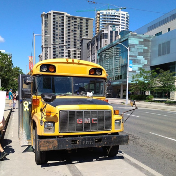 School bus driven by a fascist onto the sidewalk at the anti-hate rally in front of City Hall on August 10, 2019 (Image Credit: Karl Andrus)