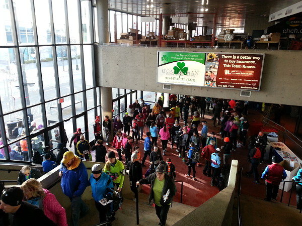 Participants, supporters and volunteers keep warm inside FirstOntario Centre before the race (RTH file photo)