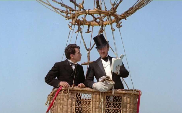 Mario Moreno (Cantinflas) as Passepartout and David Niven as Phileas Fogg consult a ballon flying manual in the 1956 film 'Around The World in 80 Days'