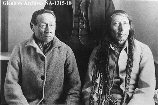 Big Bear and Poundmaker in captivity, 1886. Following the rebellion of 1885, a metis effort with little native participation, 46 metis and 81 natives were arrested. Seven metis and 44 natives were imprisoned, eight natives were hanged for murder. Big Bear's crime, in the eyes of Canadian authorities, was attempting to form an aboriginal alliance to renegotiate treaties so as to obtain contiguous reserves. A large native land block was the last thing Macdonald wanted, and his administrators in the west used hunger as a weapon to prevent it from coming about.