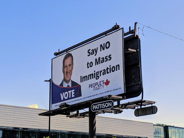 Billboard on Aberdeen Avenue west of Longwood Road promoting Maxime Bernier's racist immigration policy