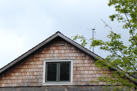 Braden's wind turbine pokes out from behind his house.