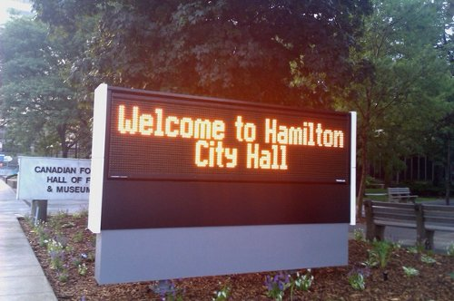 Welcome to City Hall, sign in front of 71 Main St. W.