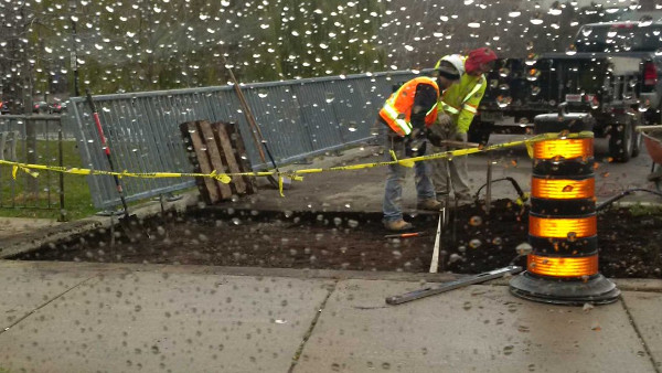 Crew installing walkway in December (Image Credit: City of Hamilton)