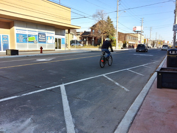 Cyclist riding in mixed traffic on Concession (Image Credit: Ryan McGreal)