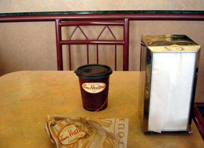 Tim Horton's coffee and unspecified confection in a paper bag