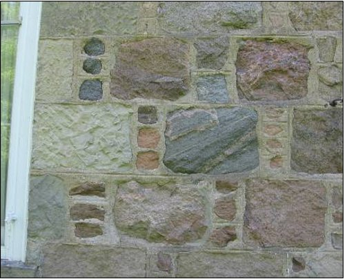 Figure 10. Detail of the side of the house shown in Figure 9. Note the variety of stones, and the careful shaping and arrangement in regular courses. The pattern of inserting a single column of 3-4 smaller stones between the larger stones is typical of Scottish stonemasonry, and is called 'Aberdeen bond.'