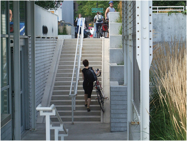 Bicycle stairs with right-handed user going up (Image Credit: Flickr)