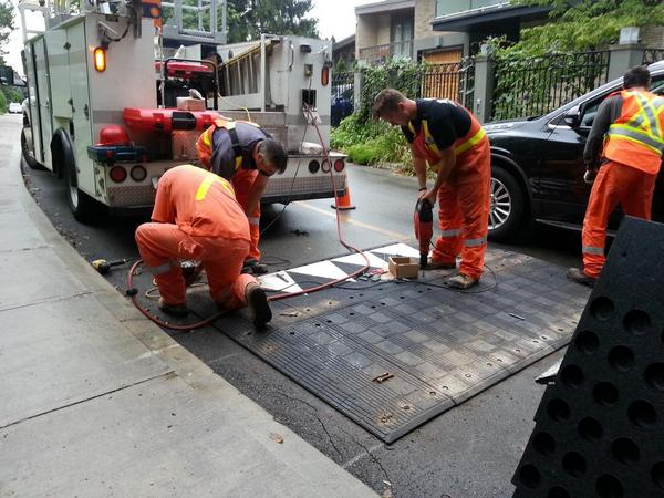 City workers install a speed hump at Glenfern and Mountain (RTH file photo)