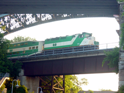 A GO train passes under the High-Level Bridge (RTH file photo)