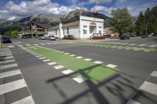 Green-marked bike lanes through intersections (Image Credit: Bike Canmore)