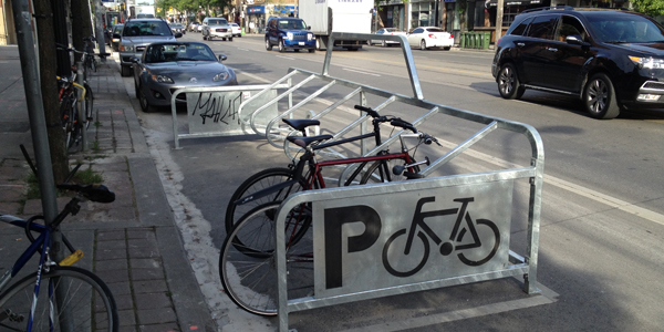 A bike corral on College St. in Toronto is a local example of what new bike corrals in high-density cycling areas could (and should) look like.