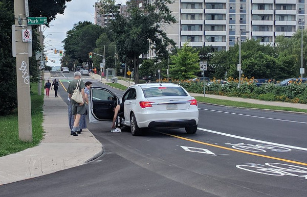 Car blocking the Hunter bike lanes at Park after driving over a knockdown stick