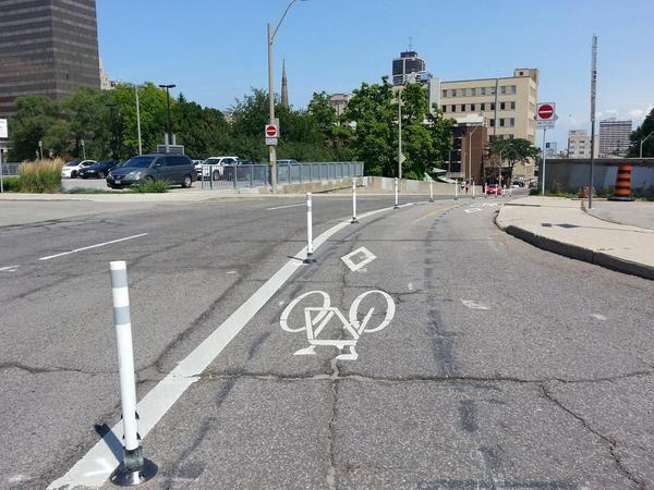 Knockdown sticks installed on Hunter Street bike lanes, looking east from Park Street