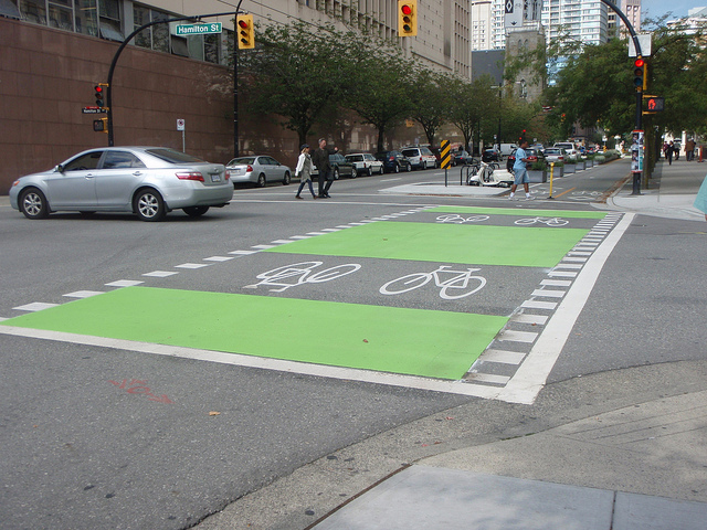 Intersection pavement markings on Dunsmuir Cycle Track, Vancouver (Image Credit: Alexander Pope/Flickr, CC-BY-NC-ND)