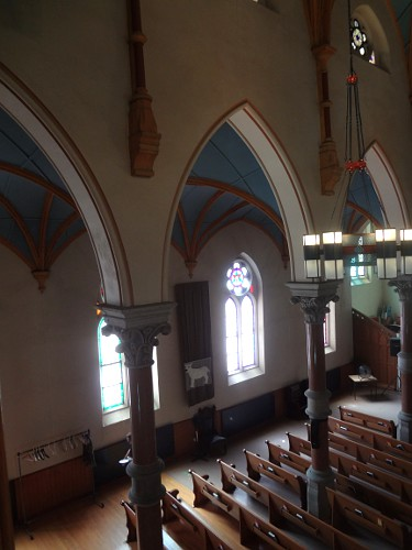 South side flanking arches and stained glass windows