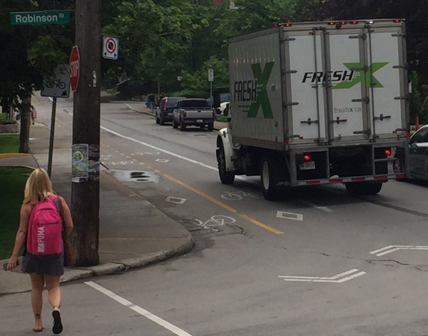 Truck almost halfway into the bike lane