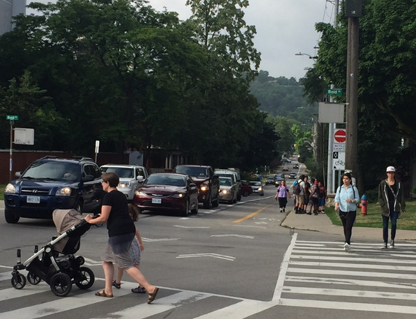 Note the large group of children, with one child walking in the bike lane