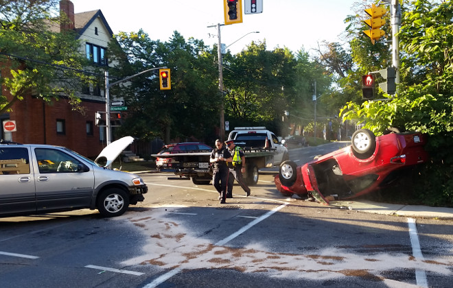 Car flipped upside-down at Queen and Charlton (RTH file photo)