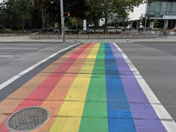 Rainbow crosswalk faded and covered in skid marks (Image Credit: Cameron Kroetsch)