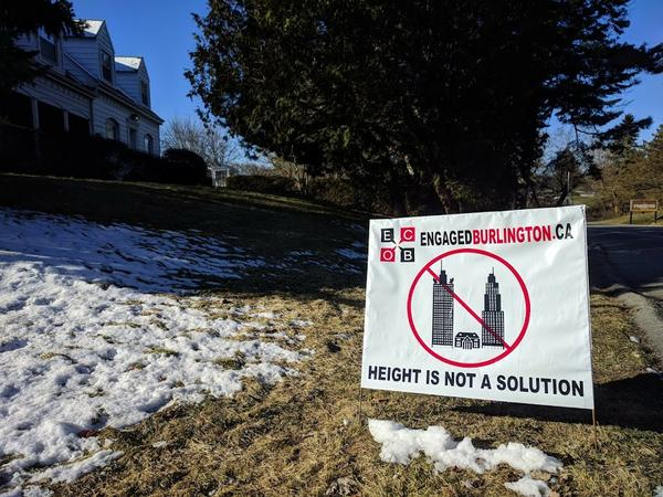 Lawn sign opposing tall buildings in downtown Burlington (RTH file photo)