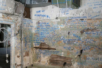 Writing on the wall inside Lister Block (Photo Credit: Joe Ceretti)