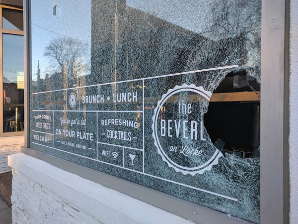 Smashed window at The Beverly