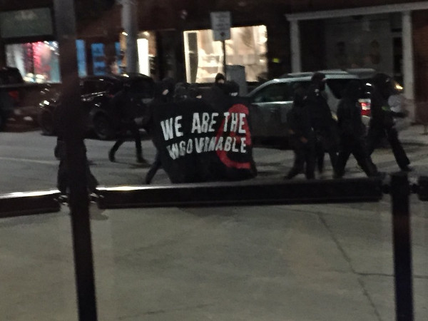 Vandals carry 'We Are The Ungovernable' banner (Image Credit: @OliverioCarmela/Twitter)