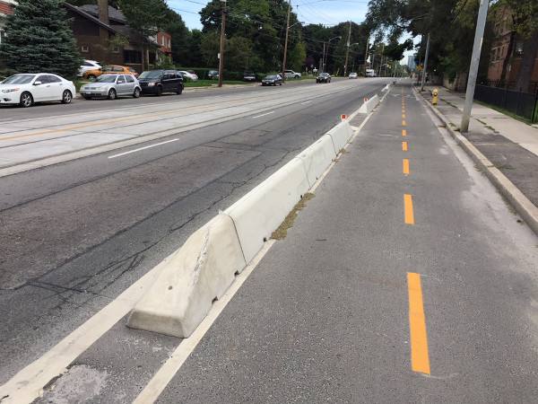 Bicycle lanes concrete protective barrier, lengthwise view