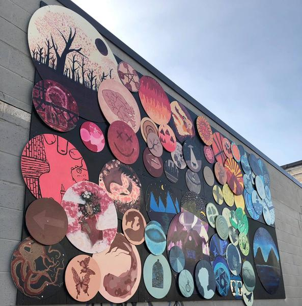 Community art installed on a property bought by Metrolinx for LRT near Wentworth Street