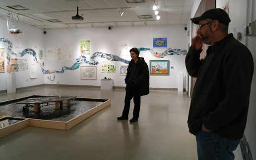 Visiting Artist Gregg Schlanger reviewing gallery show (Image credit: Judi Major-Girardin)