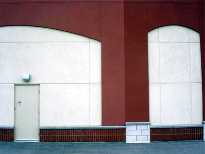 Backs of strip mall stores
