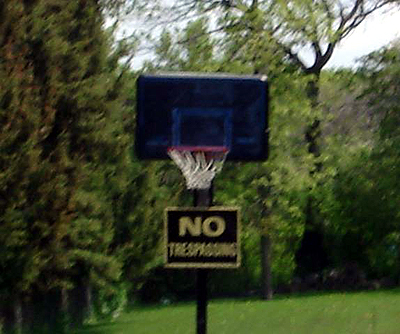 NO TRESPASSING on ... the basketball net