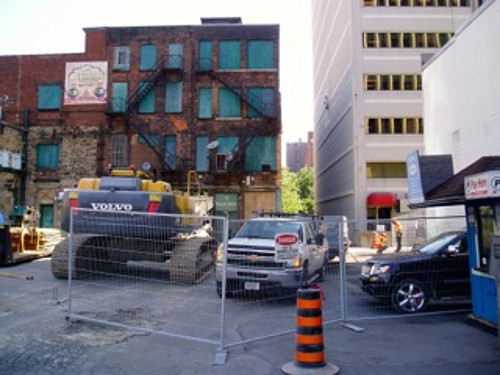 Fencing, equipment behind 18-28 King Street East (Image Credit: Eric McGuinness)