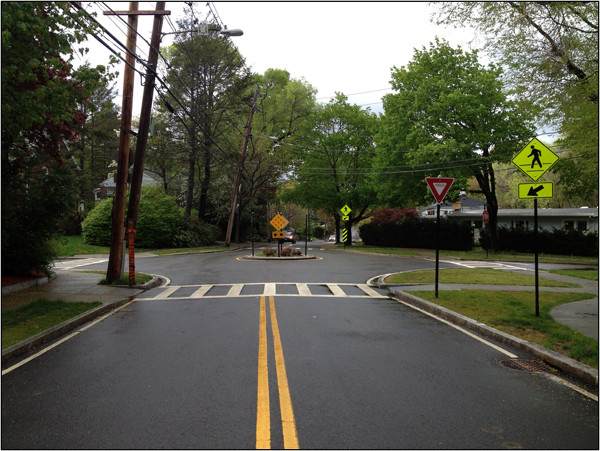 Mini-roundabout on a residential side street (Image Credit: NACTO)