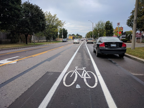 Narrower bike lane is right in the 'door zone' of parked cars