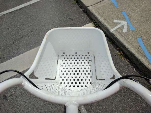 Fine mesh basket on eight-speed white SoBi bike