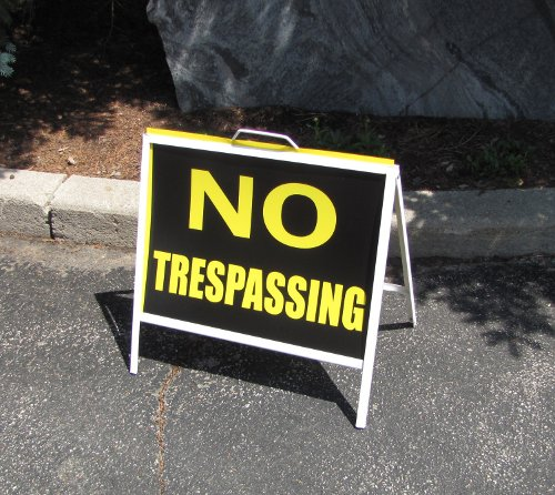 No Trespassing sign in front of the strip mall housing MP David Sweet's constituency office