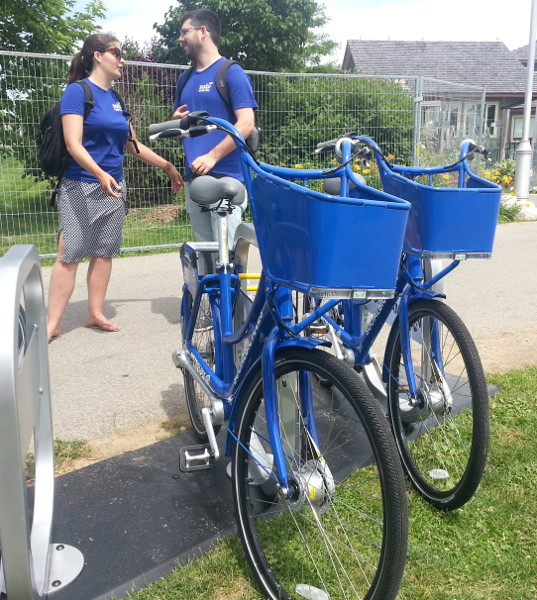 Chelsea Cox and Justin Wiley of Social Bicycles at the bike share station down by the waterfront