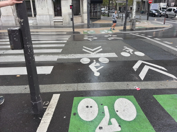 Pavement markings for off-street cycle track next to crosswalk markings