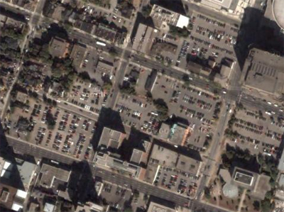 Surface parking in downtown Hamilton around Main St. W. and Bay St. (Image Credit: Google Maps)