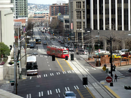 A modern streetcar winds its way through downtown Seattle.
