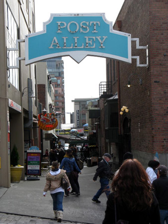 A market alleyway lined with cafes, shops and restaurants.