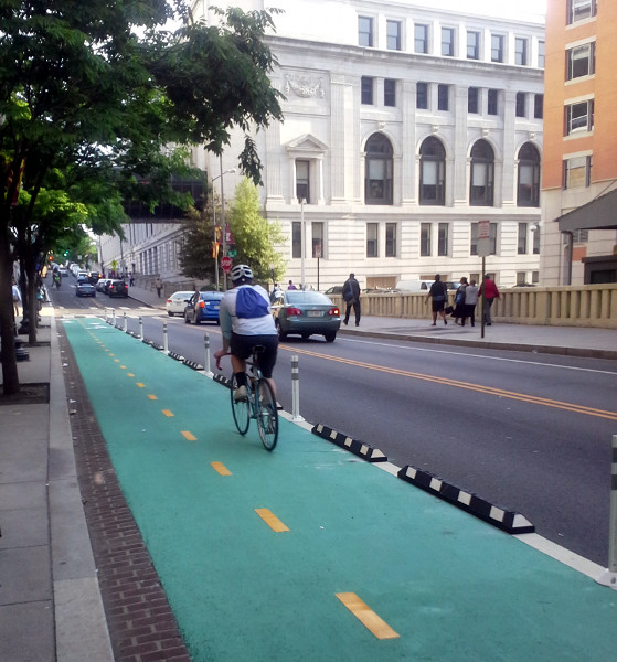 Cycle track protected by knockdown sticks and rubber curbs (Image Credit: District of Columbia Department of Transportation)