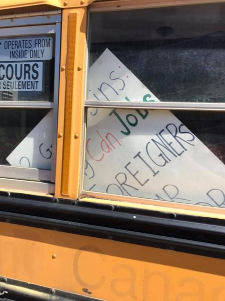 Racist sign in the window of the Yellow Vest bus (Image Credit: Tanya Ritchie)