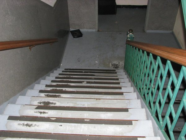 Minor repair and repainting of stair treads and landing floors.