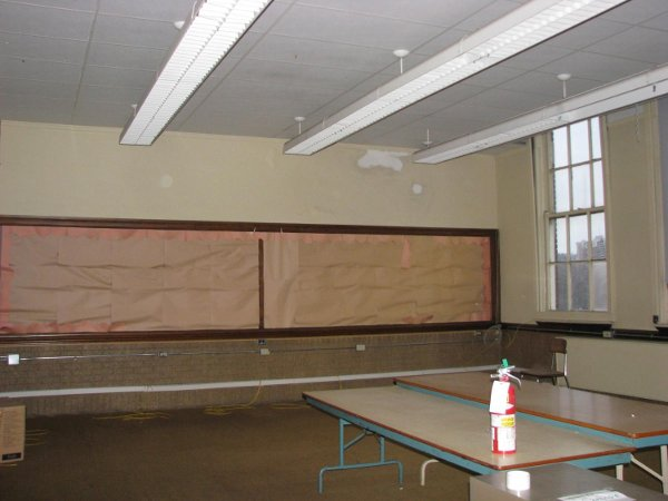 Classroom floor, walls, ceiling and windows in excellent shape.