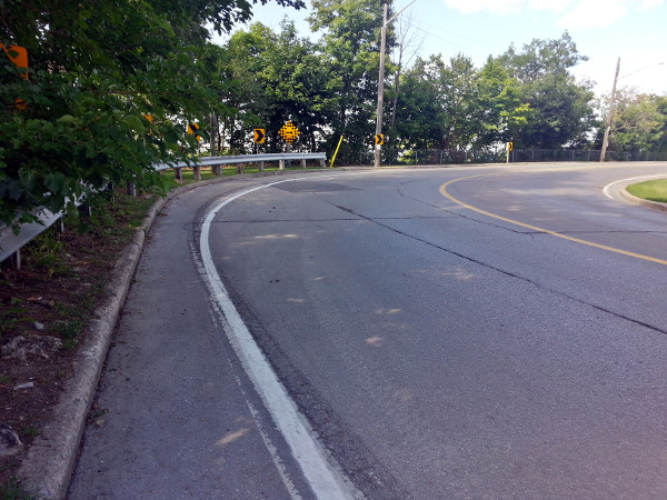 Scenic Drive bike lane gets very skinny at bend to West 35th
