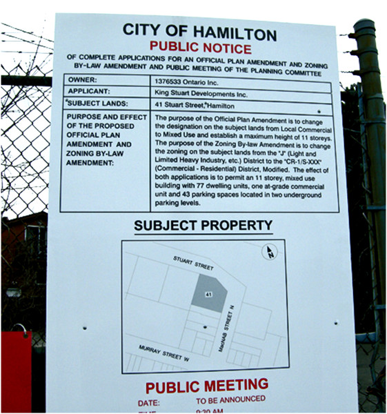 Notice of application for an Official Plan Amendment at the corner of MacNab and Stuart, kitty-corner from the entrance to the West Harbour GO station.