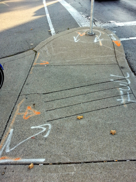 Markings on the pedestrian island at Cannon and Sherman